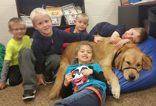 Picture of kids cuddling with Lansbury
