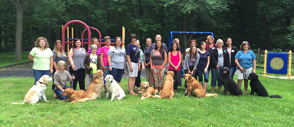 Group Picture of current School Therapy dogs and their handlers.